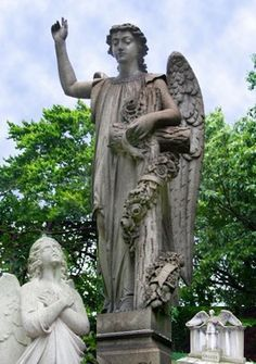 Carved angels at Lake View Cemetery, Cleveland Ohio - (© Morguefile; Licensed to About, Inc.)