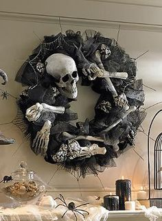 This Halloween, send chills down the spines of your guests or trick-or-treaters alike with the Bony Wreath that features an abundant mixture of black tulle, textured wire ribbon and damask ribbon topped with realistic skeletal pieces.