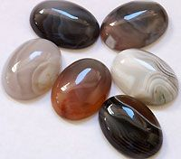 Botswana Agate - A gorgeous variety of agate originating in the African country of Botswana. It ranges from whites and greys all the way to deep chocolate tones. Sometimes it has striking wavy stripes, and other times the patterns are like clouds.