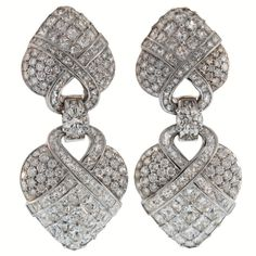 BOUCHERON Diamond Drop Earrings Each earring features 2 drops covered in almost 21 cts. of princess-cut and brilliant-cut diamonds, connected by a large round diamond centered on a simple link. Circa 1980s