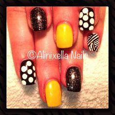 Yellow and black nail art