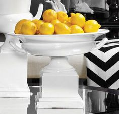 Fill a trophy bowl with bright lemons for a fresh accent.