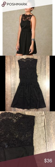 Free People black lace open side dress Free People black lace open side dress. 32 1/2 inches long. Elastic waist in back. Polyester. Tag reads XS Free People Dresses