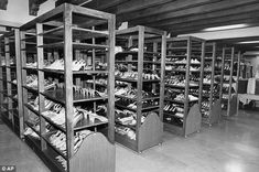 Archives: As this 1986 picture shoes Imelda Marcos' shoe stash was stored on shelves in the basement of the Malacanang Palace in Manila before being transferred to the National Museum