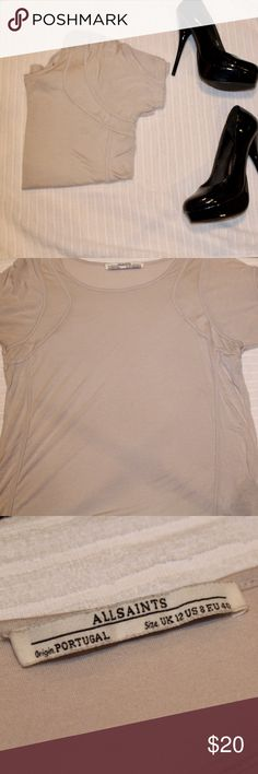 All Saints T Shirt Super soft all Saints t Shirt. Great condition, the only defect is a small hole on the back shoulder seen in the fourth picture. It's extremely small and does not take away anything from the shirt!   💕💕Closet details💕💕 Completely posh compliant closet! 🎀 no trades 🎀 no holds 🎀 offers only through offer button 🎀 very negotiable! I'm more likely to make you a better deal without the bundle feature! So talk to me and let's see what we can do! 🎀 Happy poshing! 🎀💕…