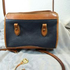 Dooney & Bourke AWL vintage shoulder bag Really good used condition Vintage Dooney & Bourke all weather leather shoulder bag.  Also comes with handles to make it a satchel.  Has some ink stains inside.  Two interior zip pockets Dooney & Bourke Bags Shoulder Bags