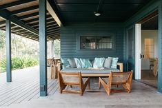 Around the corner on the wide porch of the Beach Cottage is a sitting area, anchored by two Pierre Jeanneret caned teak chairs. Beach Cottage Style, Beach Cottage Decor, Beach Cottage Exterior, Coastal Cottage, Coastal Homes, Outdoor Spaces, Outdoor Living, Outdoor Decor, Nantucket