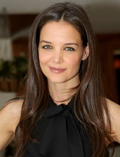 Give your straight strands a little bounce like Katie Holmes' by blowing out your hair and flicking the ends out with a small round brush.
