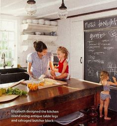 Another lovely kitchen. Note the awesome chalkboard, light fixtures, sink and island