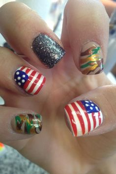 Cute camo and American flag nails.