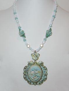 Vertigris brass filigree and hand painted dragonfly cameo, polymer, sea opal and aquamarine faceted rondelles, toggle clasp.  $42.00