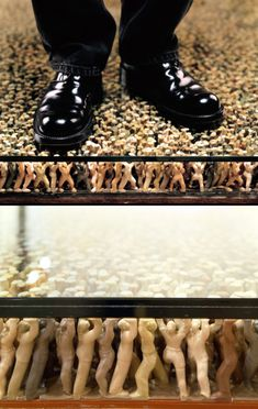 An installation by renowned artist  Do Ho Suh   - consisting of thousands of miniature plastic figurines holding up  glass plates the visi...