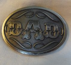 Hey, I found this really awesome Etsy listing at https://www.etsy.com/listing/232045345/pewter-dad-belt-buckle-by-spec-cast-5814
