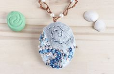 Make your very own Disney's Moana necklace that opens and closes and a glow in the dark Heart of Te Fiti gem! Free pattern printable and tutorial!