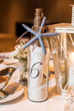 A Nautical Blue Blush and Gold Wedding in Palm Harbor Florida [ blue starfish accented message in a bottle table number. Nautical Wedding Centerpieces, Beach Wedding Centerpieces, Yacht Wedding, Bottle Centerpieces, Nautical Wedding Theme, Beach Wedding Reception, Beach Wedding Favors, Diy Wedding, Ocean Centerpieces