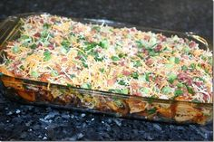 Loaded Baked Potatoe Casserole 2 lbs  chicken breasts, 1/2-inch cubes 8-10 medium potatoes, 1/2-inch cubes   1/3 cup olive oil  1 1/2 tsp. salt 1 TBS. pepper 1 TBS. paprika  2 TBS. garlic pder  6 TBS. hot sauce  Topping:  2 c Chdar &  Jk 1 c. crmbled bacon  1 c diced gr onion Poil/hot sauce mix .  Bake the potatoes for 45-50 minutes, stirring every 10-15 minutes,
