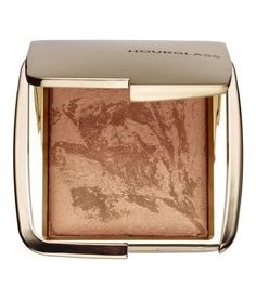 Give your face a subtle glow with a few strokes of powdered bronzer. Rather than contouring and sculpting with darker shades, stick to one closer to your natural skin tone. Ambient Lighting Bronzer, Hourglass $50
