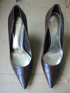 slightly used Ralph Laurent pumps in size 9 B. leather uppers.