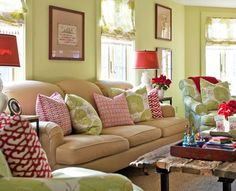 """Red accents add holiday flair to this year-round living room painted """"Dill Pickle"""" green. - Traditional Home ® / Photo: John Bessler / Design: Shazalynn Cavin-Winfrey Living Room Paint, Living Rooms, Family Rooms, Living Spaces, Savvy Southern Style, Chair And Ottoman, Fabric Sofa, Cottage Style, Cottage Chic"""