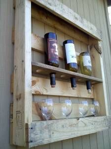 Wine holder made of a pallet. I want it first but @ Melinda, too.