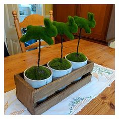 Moss bunny topiary with DIY instructions.