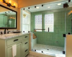 Spacious Craftsman Bathroom: note squared-off light fixtures, spacious light-filled shower. Hex floor tiles. (Weird combo of yellow and white light though... avoid that.)