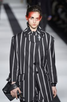 A neck sash, high uneven collar and shortened sleeves provide quirky details on @FollowWestwood's striped suit for #LFW #AW15