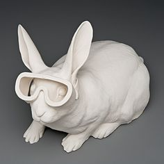 A rabbit with safety goggles. Porcelain sculpture of Kate Macdowell.