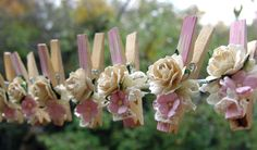 Shabby Chic Nursery decorated Clothes Pins Decorated Clothes Pegs Set of 8 pins with handmade flowers PINK paper flower. $18.75, via Etsy.