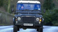 The Queen driving a Land Rover Defender in 2000