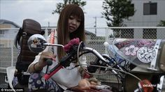 Not your typical bikie: Bosozoku girls still have tattoos, but their hair and nails are immaculate and polished, their bright bikes normally covered in stickers and multi-coloured