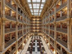 "Inside the breathtaking George Peabody Library in Baltimore, Maryland is an atrium that holds a ""Cathedral of Books"". The stunning Neo-Renaissance Architecture was designed by Baltimore architect Edmund G. Magical Library, Beautiful Library, Beautiful Buildings, Beautiful Places, Saint Florian, Fairytale Room, Peabody Library, College Library, Johns Hopkins University"