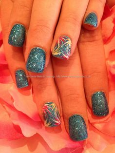 Blue glitter with freehand nail art