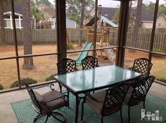 Just imagine sitting in your screened-in porch watching the kids play in the backyard!