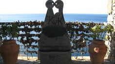 A seat designed for lovers and locks of love behind it on the Via dell'Amore ♥ Cinque Terre, Italy
