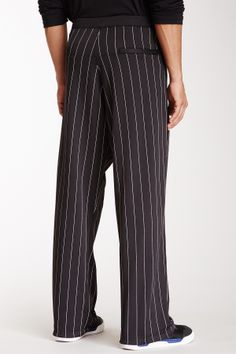 """Pinstripe Track Pant in black-black-black by Y-3 $245 - $79 @HauteLook. [back] - Elasticized waist with drawstring closure - 4 pocket construction with zip closures - Pinstripe design - 12.5"""" rise, 31.5"""" inseam Model's stats:  - Height: 6'2"""" - Waist: 32"""" - Inseam: 34"""". Model is wearing size L. Machine wash. 52% polyester, 48% cotton."""