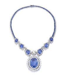 A sapphire and diamond necklace The front designed as a series of oval-cut sapphire and marquise and brilliant-cut diamond clusters, with a principal brilliant-cut diamond, weighing 2.60 carats, at the centre, suspending a detachable pendant set with a large oval-cut sapphire, weighing 57.13 carats, within borders of brilliant-cut diamonds, the highly articulated backchain composed of rows of circular-cut sapphires and brilliant-cut diamonds