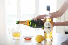 Glen Grant Cocktail - Glen Grant Scotch, Honey Syrup (Recipe), Lemon Juice, Brut Sparkling Wine  Lemon Wheel.