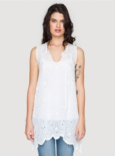 Mod Eyelet Tunic The Johnny Was MOD EYELET TUNIC will be a unique addition to your wardrobe! This tunic features scalloped eyelet detailing throughout for a graphic effect. Layer over a long slip to wear as a mini-dress, pair it with a cami and jeans, or wear it over your suit for a day at the beach - you'll find countless ways to wear this boho tunic!  - Rayon Georgette - Keyhole Neckline with Tie, Sleeveless, Scalloped Hem, Tunic Length - Signature Eyelet Detailing - Care Instructions…