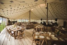 Within one of our 40 x 60' Traditional Canvas Pole Tents with scaffold board flooring.