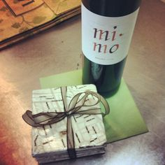 4 coasters + 1 bottle = perfect gift....all it needs is a set of glasses!