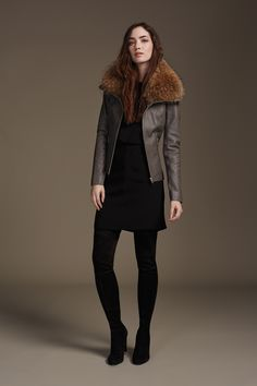 FIONNA is a slim fit lamb leather jacket with ribbed panels to create a slimmer silhouette. A generous spread collar is accented with a removable natural fur trim making this a truly versatile piece. Discover at http://www.soiakyo.com/ca/en/fionna-leather-jacket-with-fur-collar-trim-in-black-for-women