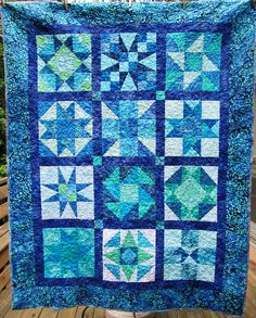 Going Coastal - Finished! A batik block of the month quilt through Tiny Stitches in Marietta GA.