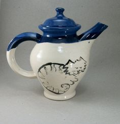 dog and cat teapot by Rith on Etsy,