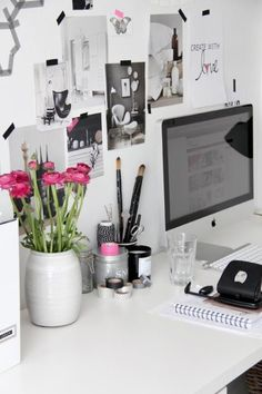 This would never be in my home but it makes me happy to look at it. So simple, so white ... and a punch of pink.  Love it!