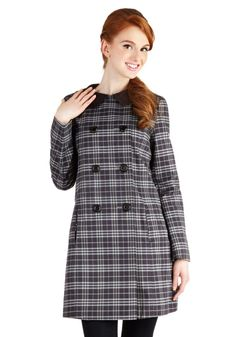 Buttoned over high-waisted sailor pants and a striped crop top, this double-breasted coat's Peter Pan collar and classic plaid of grey and navy are polished, Parisian chic.