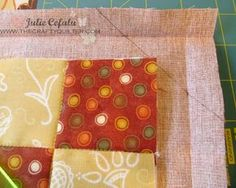 How to make mitered binding.  Use the backing fabric to wrap around to the front of your project and form a binding; rather than a separate piece of binding that is added the more traditional way.