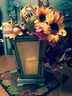 Fall lantern with sunflowers, plaid & mesh ribbon, fall leaves & berries Autumn Decorations, Fall Decor, Fall Lanterns, Mesh Ribbon, Fall Leaves, Sunflowers, Decor Crafts, Berries, Room Decor