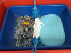 Discovery table Car Wash!  Use for transportation, community helpers themes.  clear and pebble stones, matchbox cars, microfiber scrubbers from the dollar tree, shaving cream, and blue flubber for the water!