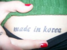 'made in korea'. i got this tattoo right after my 19th birthday.